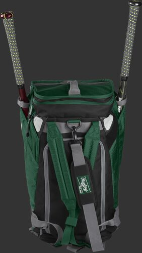 A dark green R601 Rawlings Hybrid duffel/backpack standing up with two bats