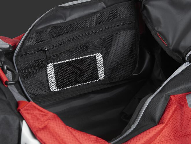 A phone inside the mesh accessory pocket inside the main compartment of a scarlet R601 Hybrid bag