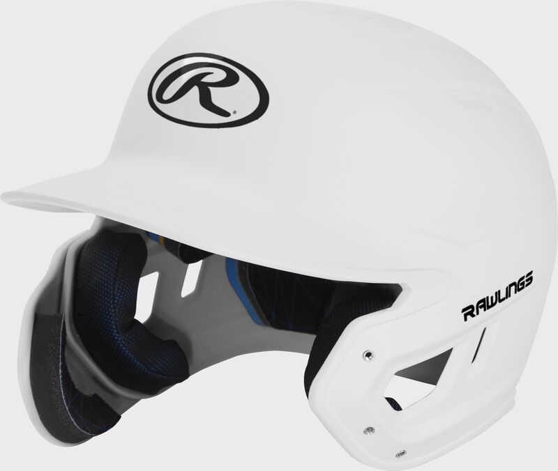 Left angle view of a MACHEXTL Rawlings Mach EXT Junior helmet with a one-tone matte white shell