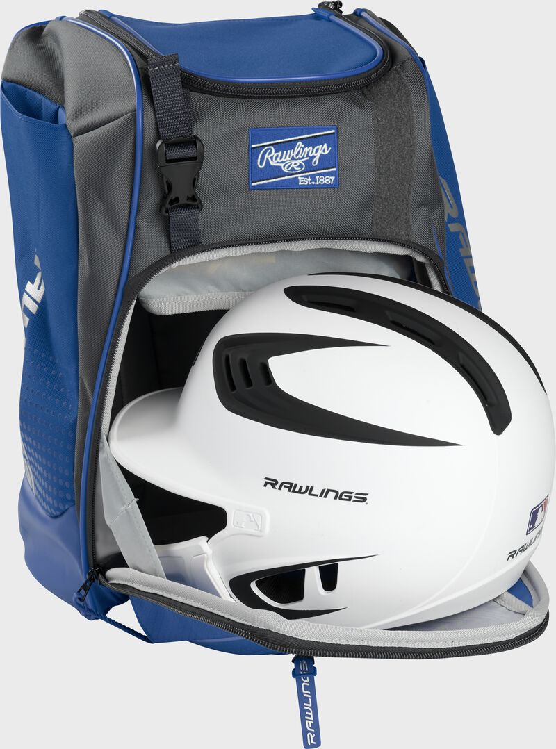 A white/black helmet in the main compartment of a royal Rawlings Franchise backpack - SKU: FRANBP-R