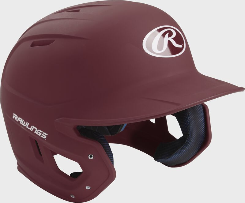 Right angle view of a matte MACH batting helmet with a maroon shell