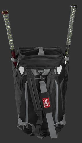 A black R601 Rawlings Hybrid duffel/backpack standing up with two bats