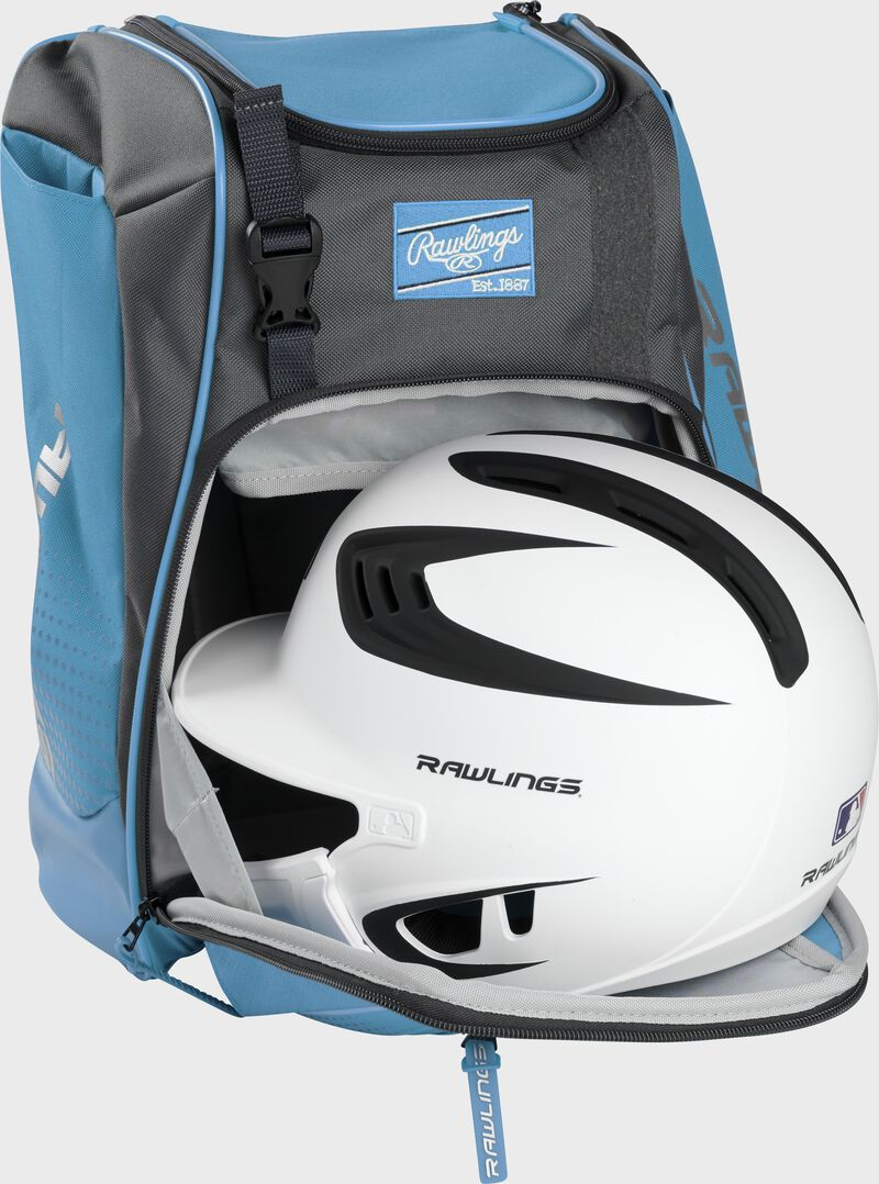 A white/black helmet in the main compartment of a Columbia blue Rawlings Franchise backpack - SKU: FRANBP-CB