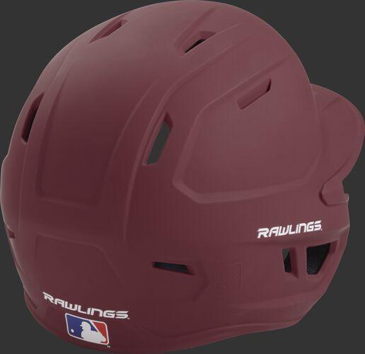 Back right of a one-tone matte maroon MACH Rawlings batting helmet