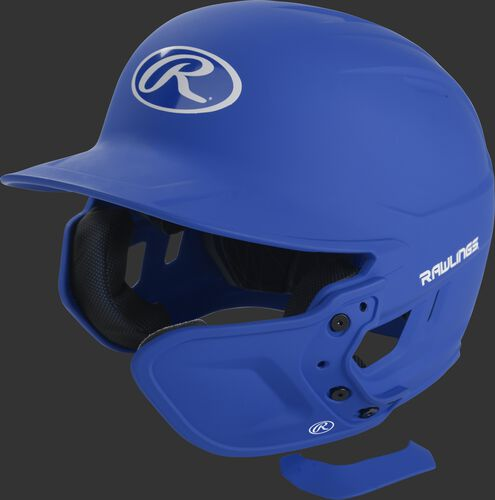 A matte royal MEXT attached to a Mach batting helmet showing the hardware