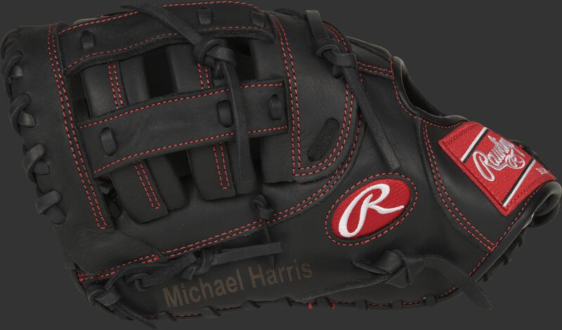 Thumb view of a blemished black 12-inch Gamer 1st Base mitt with Michael Harris engraved on the thumb