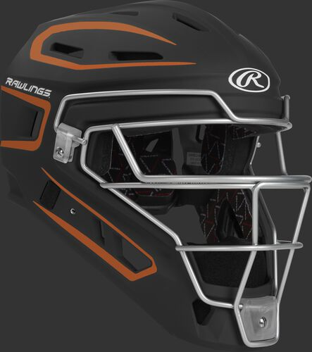 Front right of a black/orange CHV27J Rawlings Velo 2.0 catcher's helmet