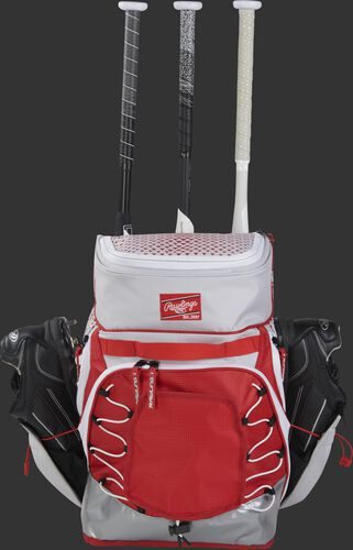 A white/scarlet R800 fastpitch backpack with shoes in the external shoe storage and 3 bats in the bat compartment