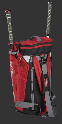 Right angle of a scarlet R601 Hybrid players duffel bag standing up with two bats
