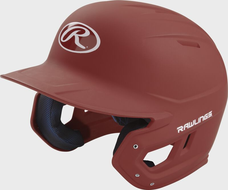 Left angle view of a Rawlings MACH helmet with a one-tone matte cardinal shell