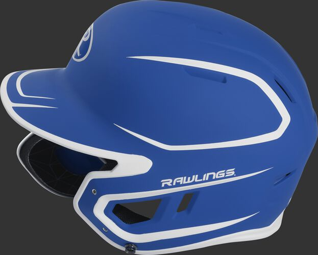 Left side of a MACHEXTR senior Rawlings batting helmet with a two-tone matte royal/white shell
