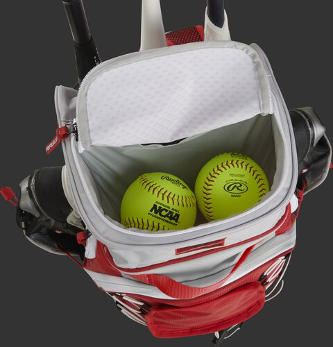 Top compartment of a white/scarlet R800 fastpitch backpack with 2 softballs