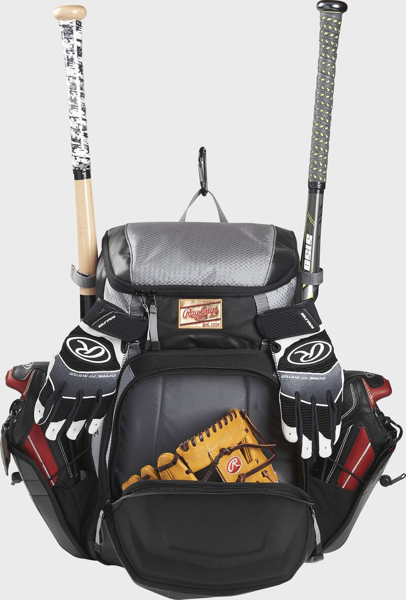 Front compartment of a black/gray R1000 Rawlings Gold Glove Series backpack with a glove and batting gloves