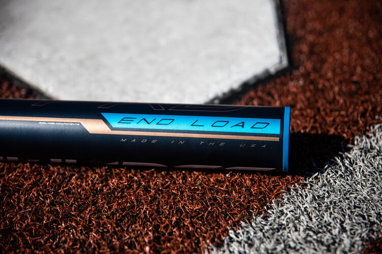 Barrel of a end-loaded Quatro Pro fastpitch bat lying next to home plate - SKU: FPPE9