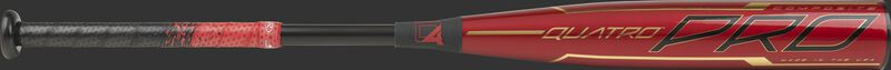 Barrel of a red BBZQ3 2020 Quatro Pro BBCOR bat with black and gold accents