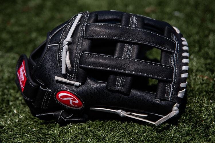 A black RSB H-web glove lying on a field - SKU: RSB130GBH