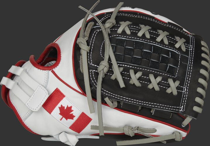 A white PRO716SB-18CAN 12-Inch HOH Canada softball glove with a black double-laced Basket web and Canadian flag on the thumb