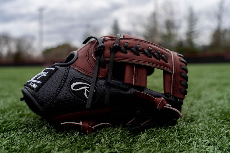 Thumb of a 2020 HOH exclusive Croc infield glove sitting on a field - SKU: PROTT2-19SHC