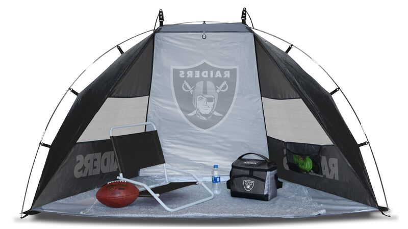 A Las Vegas Raiders sun shelter set up with a chair, cooler, football and water bottle on the ground - SKU: 00961072111