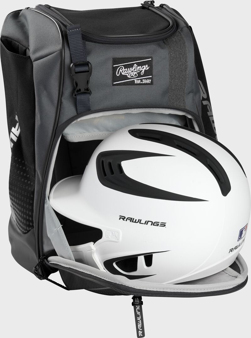 A white/black helmet in the main compartment of a black Rawlings Franchise backpack - SKU: FRANBP-B