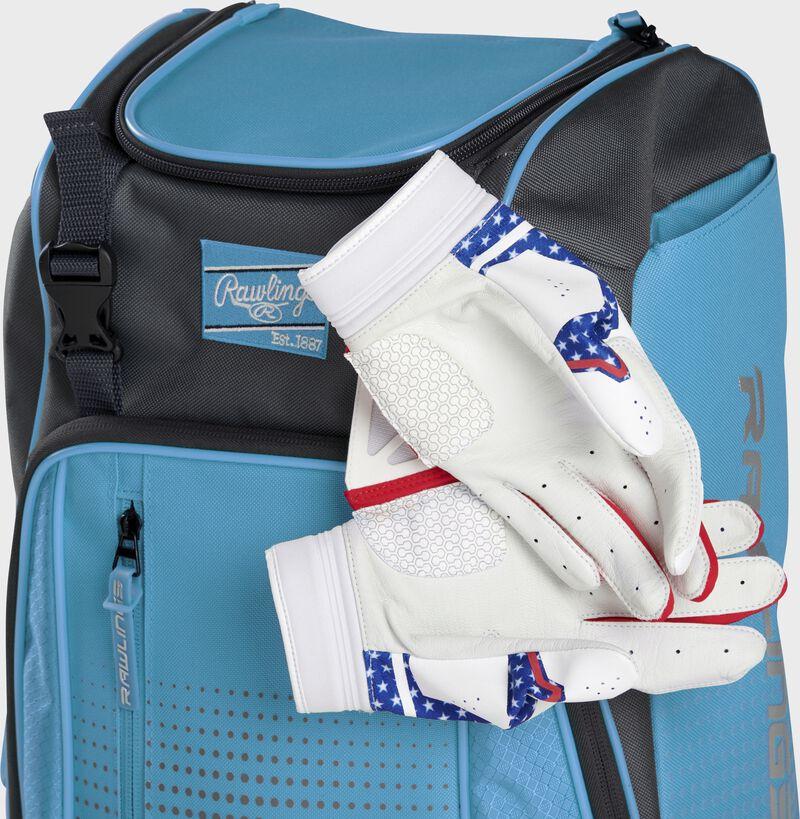 Two batting gloves hanging on the front Velcro strap of a Franchise baseball backpack - SKU: FRANBP-CB