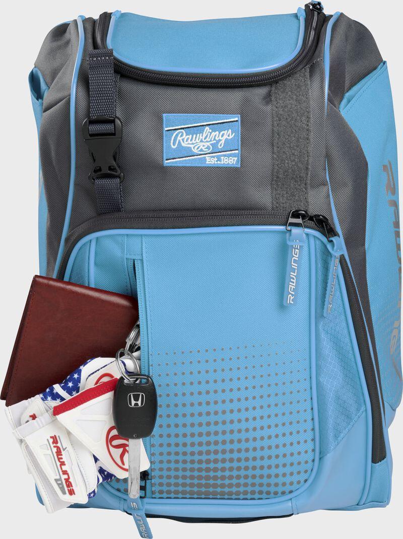 Wallet, keys, and batting gloves in the front valuables pocket of a Columbia blue Franchise baseball bag - SKU: FRANBP-CB