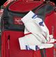 Two batting gloves hanging on the front Velcro strap of a Franchise baseball backpack - SKU: FRANBP-S image number null