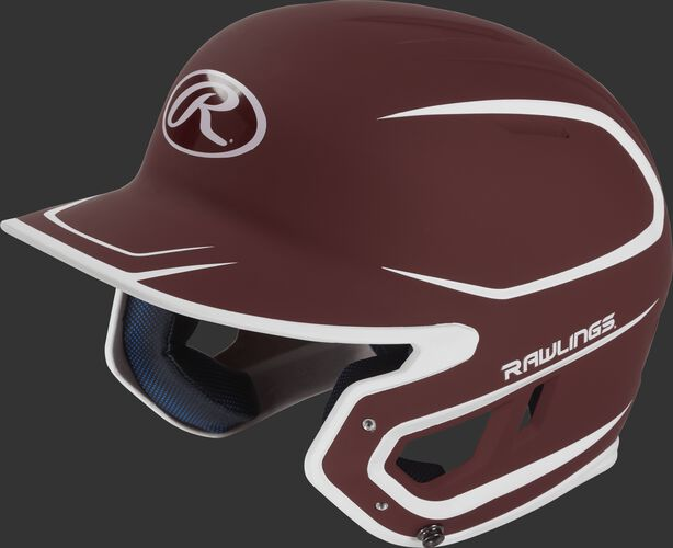 Left angle view of a Rawlings MACH Senior helmet with a two-tone matte cardinal/white shell