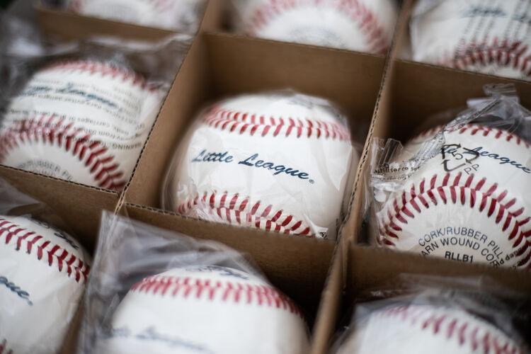 A Rawlings Little League baseball in a box of balls - SKU: RLLB1
