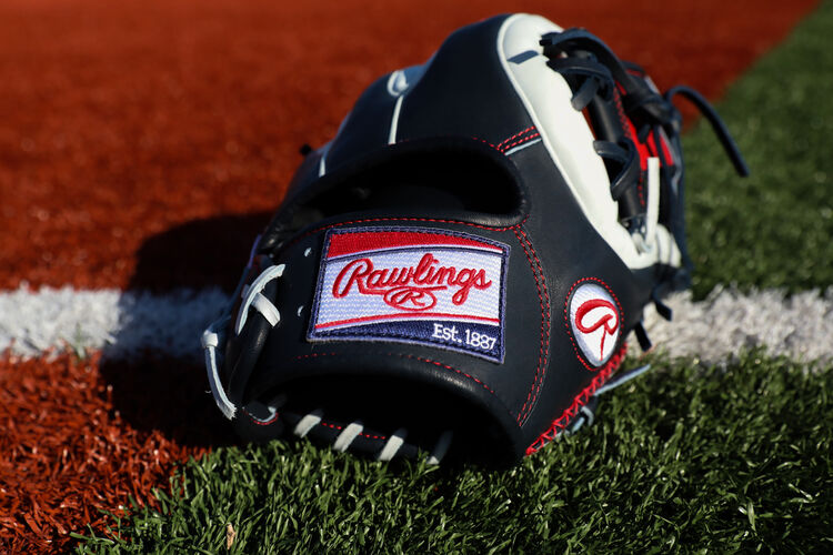 White/scarlet/navy Rawlings patch on a HOH ColorSync 5.0 infield glove on a field - SKU: PRO314-2NW