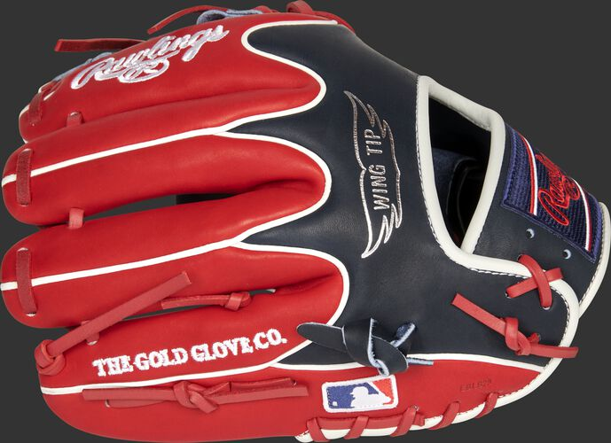 Scarlet/navy back of a Cleveland Indians Heart of the Hide infield glove with the MLB logo on the pinky - SKU: RSGPRO204W-2CLE