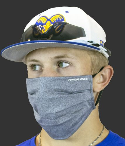 Angle view of a player wearing a heather gray Rawlings sports mask - SKU: RMSKE-HGRY