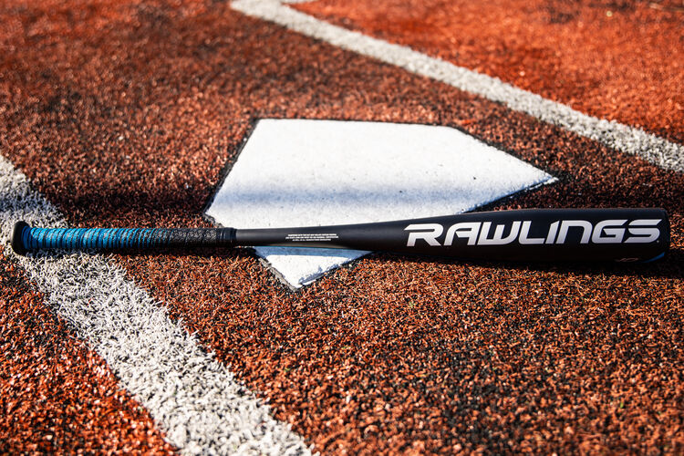 Rawlings logo on the barrel of a Rawlings 5150 USA baseball bat on a field at home plate - SKU: US15