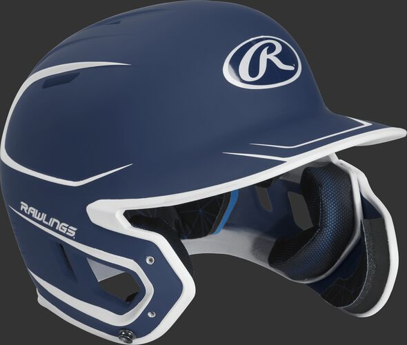 Right angle view of a MACHEXTR Rawlings Mach EXT Senior helmet with a two-tone matte navy/white shell