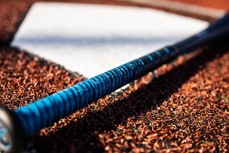 Blue grip on a USA 5150 baseball bat next to home plate - SKU: US15