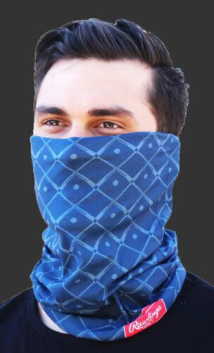 A guy wearing a navy Rawlings adult multi-functional head and face cover around his mouth and nose - SKU: RC40005-400