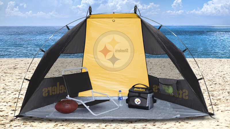 A Pittsburgh Steelers sun shelter set up on a beach with a chair, cooler, football and water bottle - SKU: 00961082111