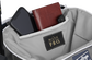 Zippered pocket in the top storage compartment of a navy Impulse backpack with a phone, wallet and keys - SKU: IMPLSE-N image number null