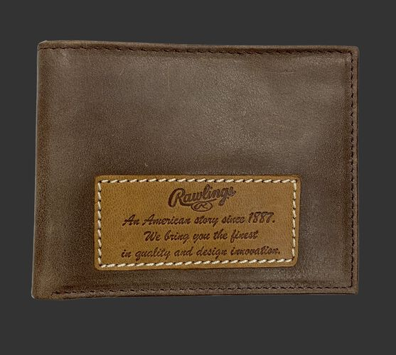 A brown American Story bi-fold wallet with a leather patch on it telling the Rawlings American story - SKU: RPW001-200