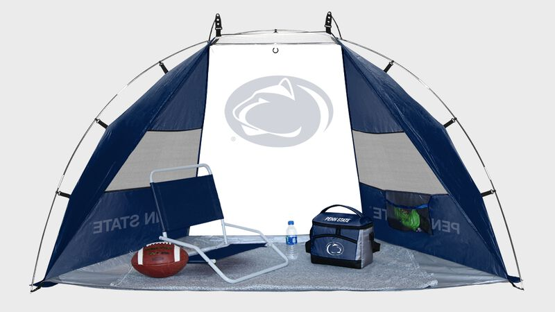 A Penn State Nittany Lions sun shelter with a chair, football and cooler