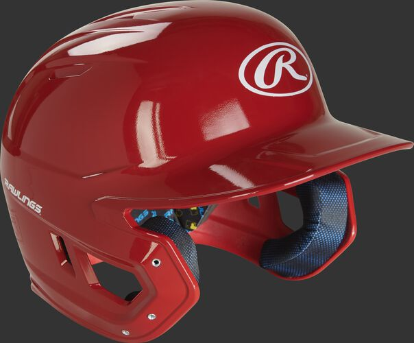 Right angle view of a MCH01A Rawlings Mach helmet with a scarlet shell