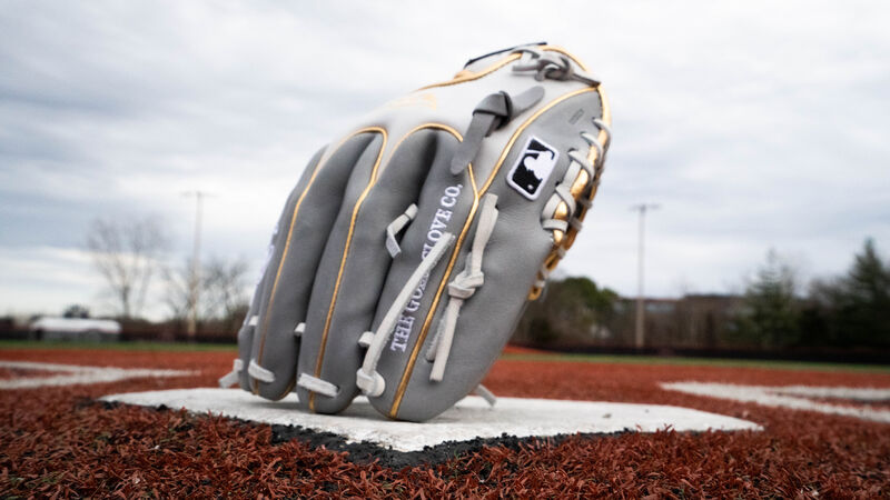 A HOH Wing Tip infield glove standing on its finger tips on home plate - SKU: PRO204W-2GW