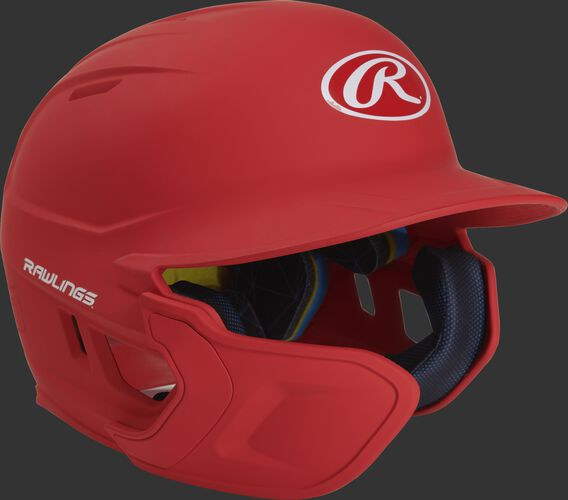Right angle view of a matte scarlet MACHEXTL Mach Senior helmet with Mach EXT left hand batter face guard extension
