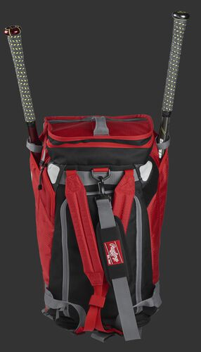 A scarlet R601 Rawlings Hybrid duffel/backpack standing up with two bats