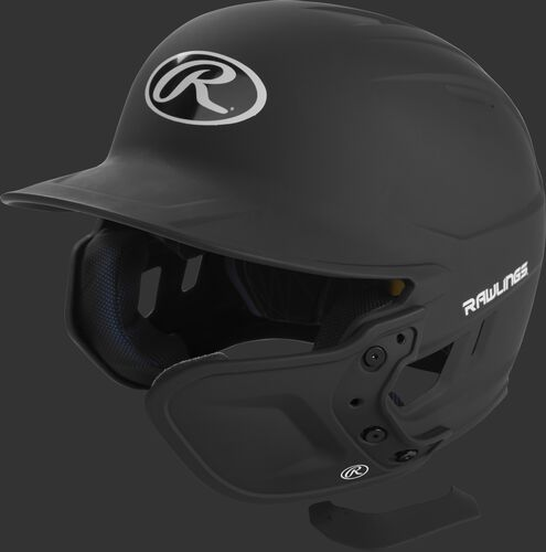 A black MEXTR attached to a Mach batting helmet with the removable TPU piece off to show the hardware