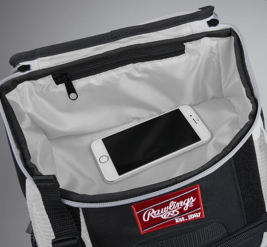 Top accessory pocket of a black/white R500 equipment backpack holding a phone