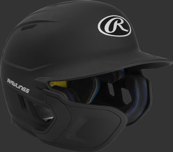 Right angle view of a matte black MACHEXTL Mach Junior helmet with Mach EXT left hand batter face guard extension