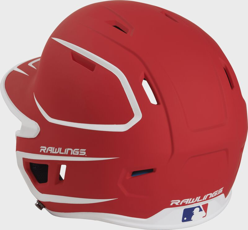 Back left view of a matte scarlet/white MACHEXTR MACH series two-tone batting helmet with air vents