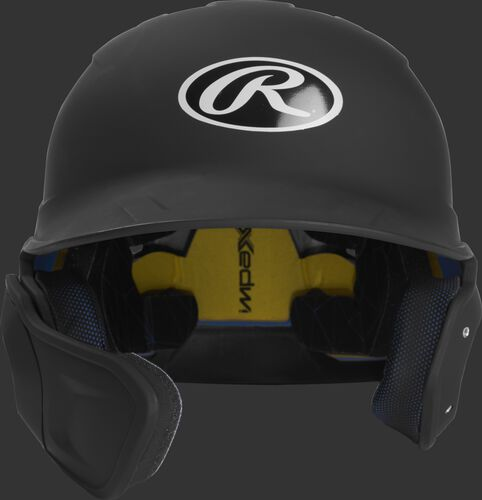 Front of a matte black MACHEXTL junior size Mach batting helmet with face guard extension for left hand batters