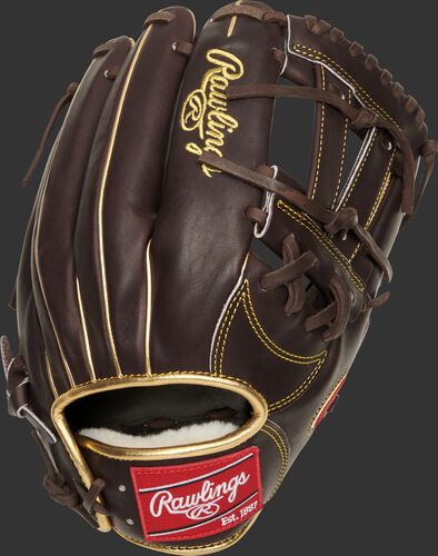 Back of a mocha Manny Machado Pro Preferred infield glove with a red Rawlings patch - SKU: PROSNP7-MM13